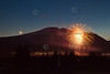 In this Hand Out photo provided by Nathan Bilow Photography, shows an early Independence Day celebration as fireworks explode in the air over the town of Crested Butte, Colo. with the crescent moon setting over the silhouette of Mount Emmons, also known as The Red Lady, on Sunday, July 3, 2011. (AP Photo/Nathan Bilow)