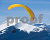 A paraglider pilot, Ben Eaton of Crested Butte, Colo. flies in the sky on a beautiful day in Colorado on Tuesday, March 16, 2010. Mount Emmonds also known as The Red Lady is seen in the background where a large number of Crested Butte residences are against it's mining operation for molybdenum. (Photo/ Nathan Bilow)