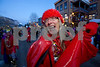 "Gloria ""Glo"" Cunningham of Crested Butte, Colo. engages in the festivities of the Fat Tuesday Mardi Gras parade on Elk Avenue, main street, Crested Butte on Tuesday, Feb. 16, 2010. A large number of unexpected visitors watched the miniature parade this year. Glo is part of the Red Lady Krewe which opposes the mining of the nearby mountain. (Crested Butte Mountain Resort Photo/Nathan Bilow)"