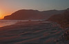 The Rosy Glow of Sunset over the sand