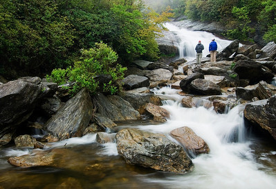 A couple enjoying Second Falls, Graveyard Fields, milepost 418, Blue Ridge Parkway, NC.