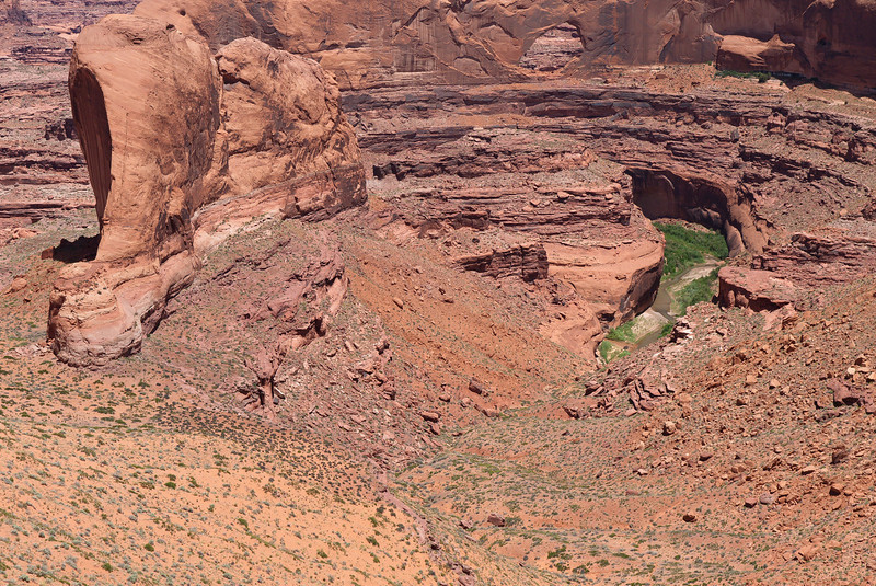 Looking down at Escalante take out and Steven's Arch in BG.