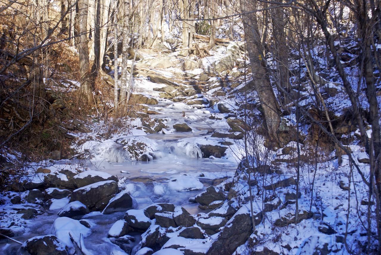 Frozen snowy creek near Glen Ayre, North Carolina