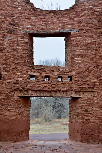 NM-SPM-Quarai3 2019.11.11#2860.1x. Header detail over a main door and window. Salinas Pueblo Mission Quarai. North of Mountainair, New Mexico.