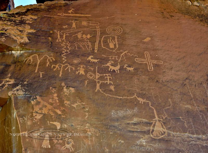 NV-VOF-AR2018.12.13#071.2. Atlatl petroglyphs plus many other symbols and bighorn sheep. Atlatl Rock, Nevada.