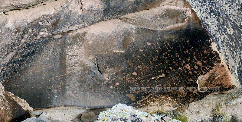 "AZ-PFNP2017.9.17#3865-Petroglyphs near the ""Newspaper Rock"". Petrified Forest Nat. Park Arizona. 1250 A.D. to the late 1300's."