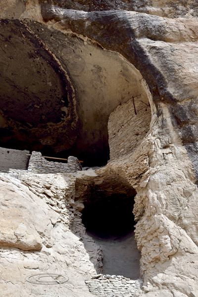 NM-GCD25-2019.11.9#4034.3. Gila Cliff Dwellings. A small cave underneath the dwellings, probably used as a storage room. Gila Wilderness, New Mexico.