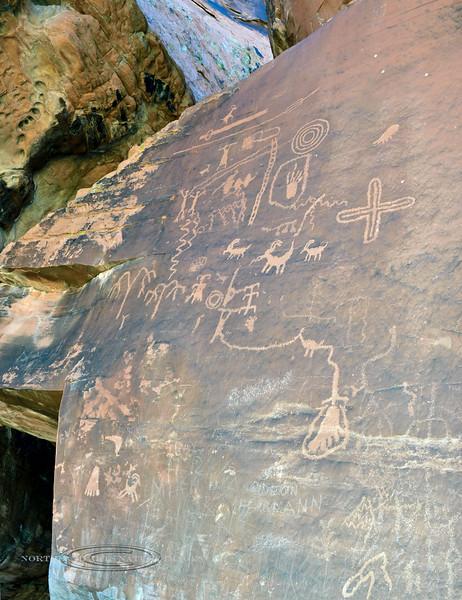 NV-VOF-AR2018.12.13#3081.2. Atlatl petroglyphs from the Basketmaker culture. Atlatl Rock, Nevada.