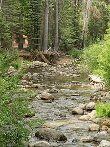 View of creek from bridge, looking downstream.