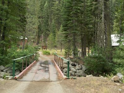 Entrance to campus via bridge over creek
