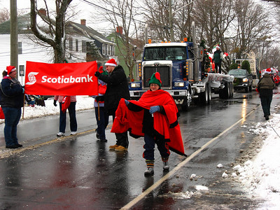 SANTA'S XMAS PARADE - Manawagonish Rd - Scotiabank folks are gathering canned goods