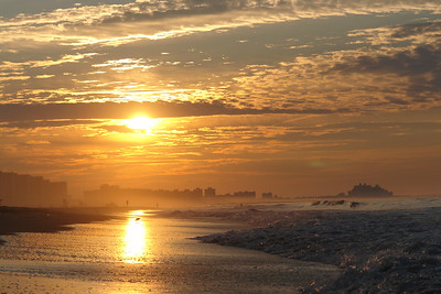 SUNRISE AT THE ROCKAWAY BEACH
