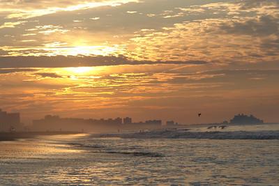 SUNRISE AT THE ROCKAWAY BEACH