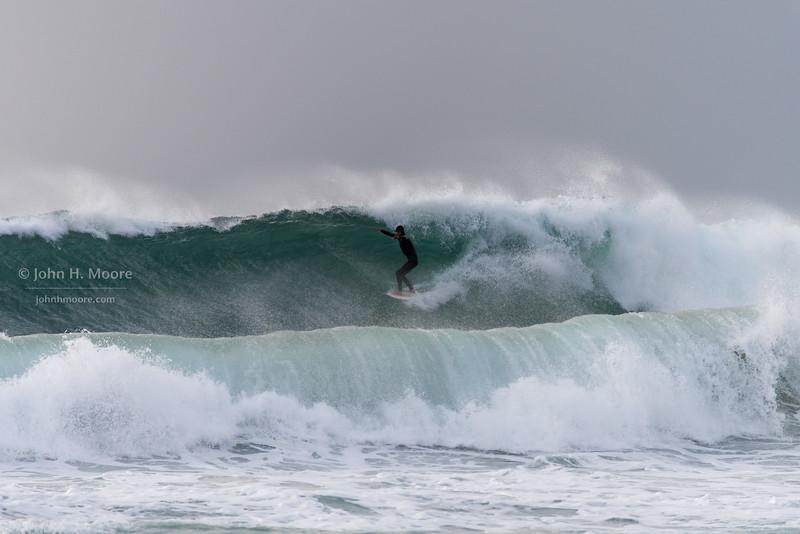 How big is that wave?  Surfer drops in on a big set at La Jolla Shores.  La Jolla, California, USA.