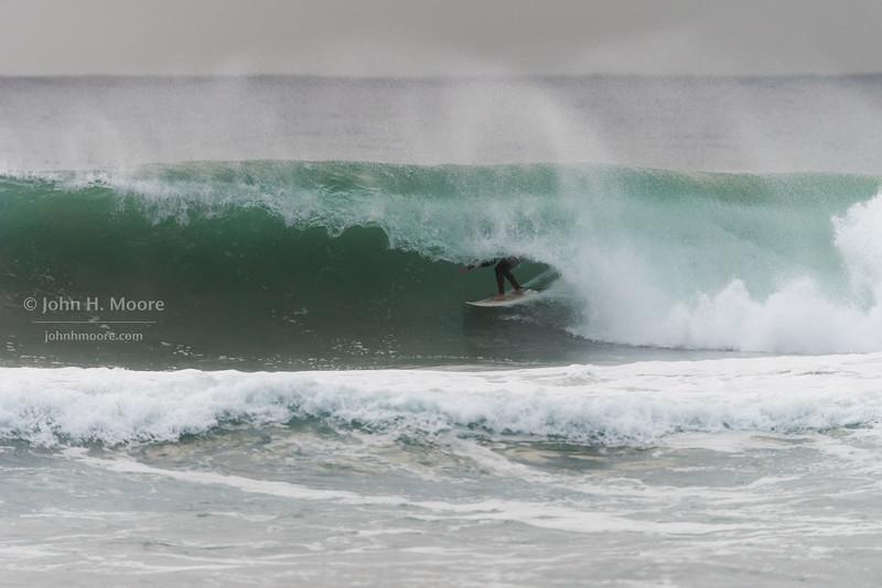 Surfer inside a barrel at La Jolla Shores.  La Jolla, California, USA.
