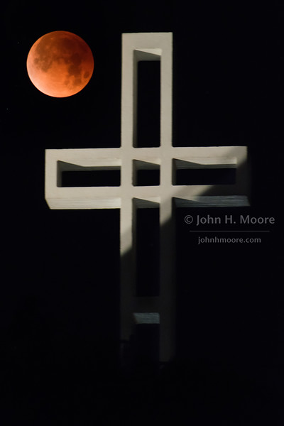 "A total lunar eclipse behind the Mount Soledad Cross in La Jolla, California, USA.  ""Super Blue Blood Moon"" of January 31, 2018."