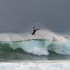 A surfer does a flip off the backside of a wave at La Jolla Shores.  La Jolla, California, USA.
