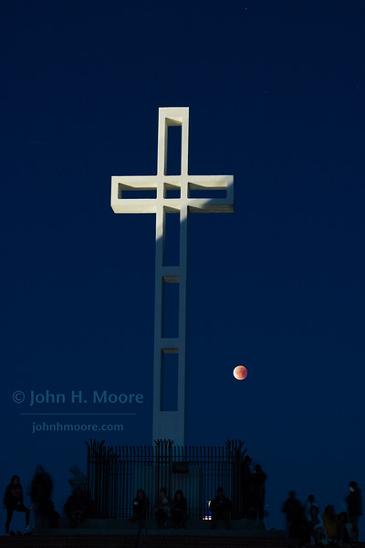 "A crowed gathers at the Mount Soledad Cross in La Jolla, California, to watch the ""Super Blue Blood Moon"" total lunar eclipse set.  January 31, 2018"