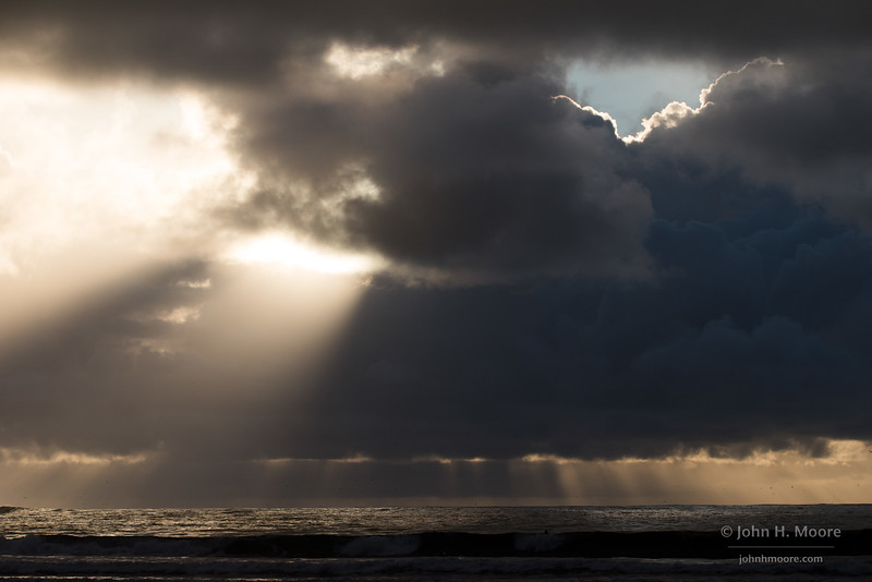 Stormy skies and light beams off La Jolla, California, USA.
