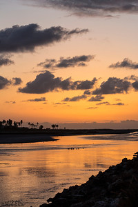 Sunset over the San Diego River just after low tide.