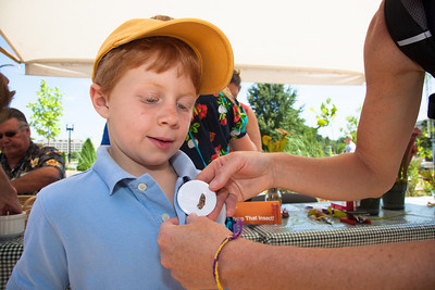 Wesley Perkins (age 7) from Park City Utah gets an insect button