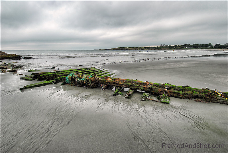 "<strong><Center>Driftwood</strong></center> Newport in Rhode Island.  This washed up contraption looks distinctly ""man made"", maybe it was a pier or a bridge, somewhere – and then the storm, or the time braked it loose. Drifted by the sea for some time, before it ended up on the beach and was captured and eternalized."