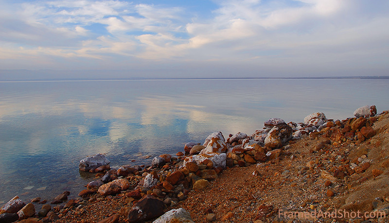<strong><Center>Dead</strong></center> This is the Dead Sea, taken from the Jordanian side looking towards the West Bank.  The water is extremely clear, as nothing lives or grows in the hypersalinety.  If the clear water makes reflections clearer and more colourful is doubtful.