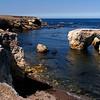CLIFFS, SEA STACKS, NATURAL BRIDGES, AND SOLITARY GULLS.