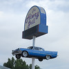The Highway Grill in Aztec, NM with a '58 Desoto in the air. They get more comments on that than anything!