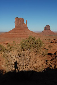 © Joseph Dougherty.  All rights reserved.   Sandstone formations in Monument Valley, Navajo Nation, northern Arizona.  Self-portrait in silouette.