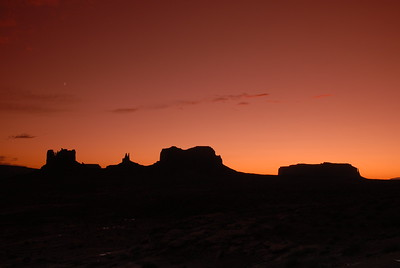 © Joseph Dougherty. All rights reserved.   Colorful sky and clouds at sunset in Monument Valley, Navajo Nation, northern Arizona.