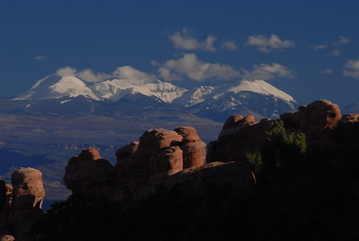 © Joseph Dougherty. All rights reserved.   Fossilized sandstone dunes beneath the snowcapped peaks of the La Sal Mountains.