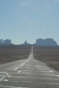 © Joseph Dougherty. All rights reserved.   A long blacktop road stretches down into Monument Valley.  Navajo Nation, northern Arizona.