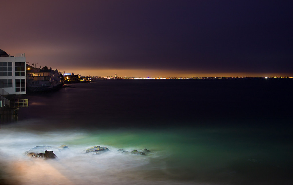 A view of the waters of Malibu just after dusk.  Santa Monica and Los Angeles can be seen in the distance.