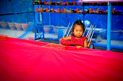 Kid at a fair, Sukhothai (Thailand)