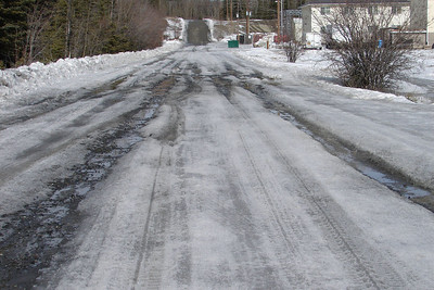 April 11, 2009:  About halfway through breakup, still too much ice to safely negotiate this side road with a motorcycle, but it won't be long.