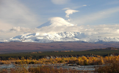 9/18/06 - Mt. Sanford, viewed across the Chistochina River, with a cloak of snow descending to meet the brilliant fall foliage.