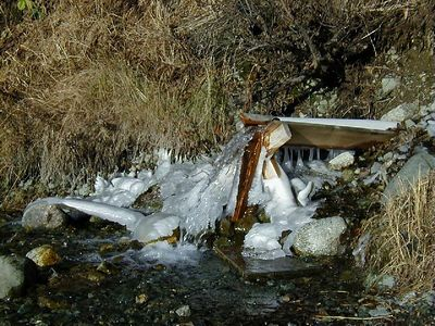 Cold weather has almost brought a seasonal halt to this roadside spring's flow.