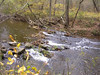 The Middle Patuxent River rushing over stones.<br /> <br /> 10-23-06