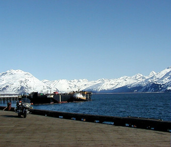 While the mountains surrounding Port Valdez are still shrouded with snow, the dock and city streets have long since been warmed and dried by the spring's abundant sunlight.