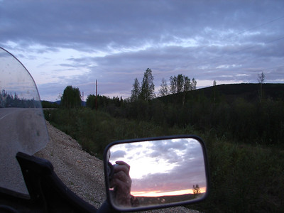 5/31/07 - North of Fairbanks on the Elliott Hwy, this photo taken at 12:07 AM AKDT, with the bike facing southeast, the mirror facing northwest.