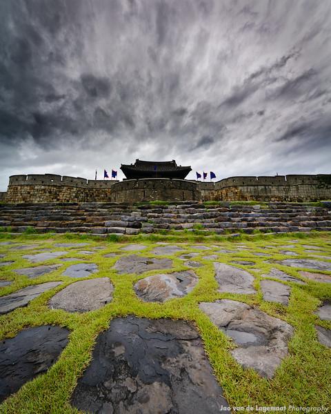 Suwon Castle . Read more: http://lagemaat.blogspot.com/2012/08/suwon-korea-during-typhoon.html