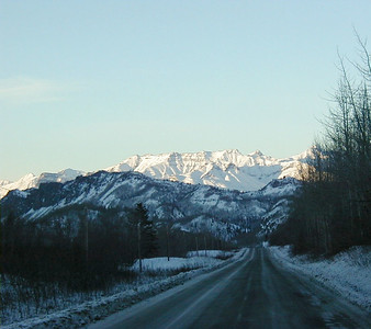 The Glenn Hwy., just west of Caribou Creek.  This stretch is now three lanes wide, with a more gentle, steady descent and a better view of the Matanuska Glacier.