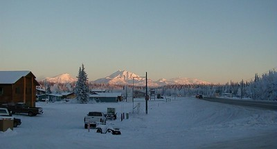 "A view of the Wrangell Mts. - Mt. Sanford, Mt. Drum, and Mt. Wrangell - over ""downtown"" Glennallen."