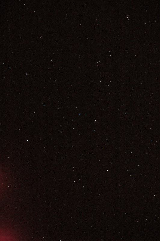 Aiming further up; you can see the flare from the lodge's light in the lower left corner. I'm amazed how many different colors the stars and galaxies are, almost like a Hubble photo.