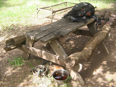 Pots, pans, picknick table, beds, what else could possibly want at a remote campsite, oh also Horse shoes.