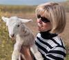 Clarita hold newborn lamb, not yet one day old.