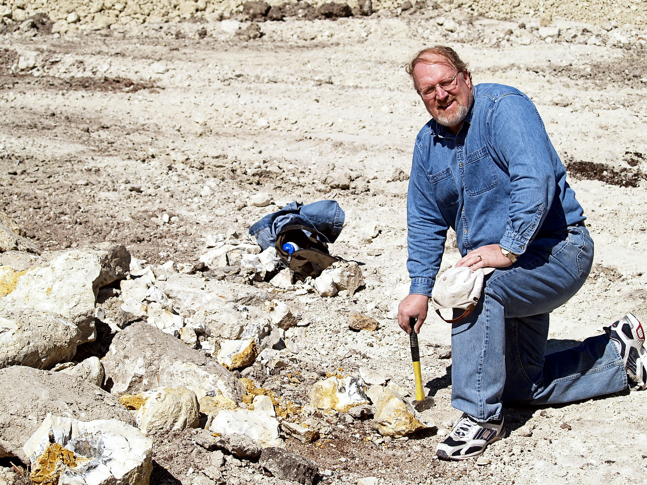 OLYMPUS DIGITAL CAMERA--Al Cherepon next to concretions filled with<br /> crystals.