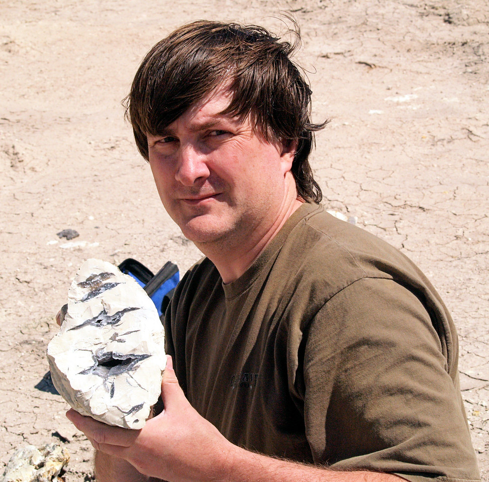 OLYMPUS DIGITAL CAMERA--Brian holding a highly fluorescent piece<br /> of a concretion.