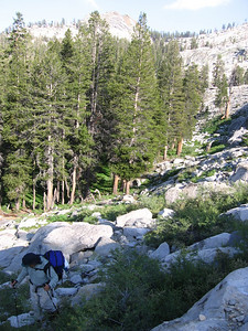 Wending our way up through the talus and brush, in the late-afternoon sunlight.